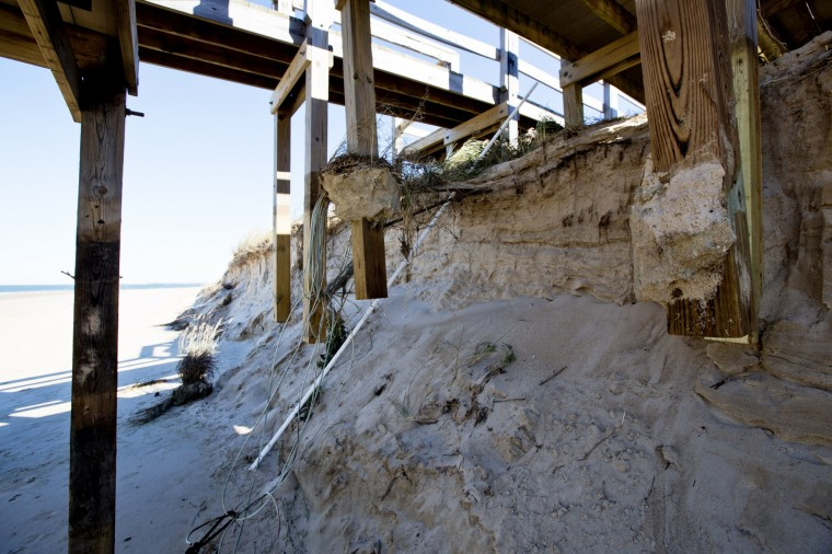 The pillars on a boardwalk at the Cape Henry beach in Virginia Beach are exposed Monday, Nov. 3, 2014, after recent storms that washed away about 15 feet of dune. (Thé N. Pham | The Virginian-Pilot)