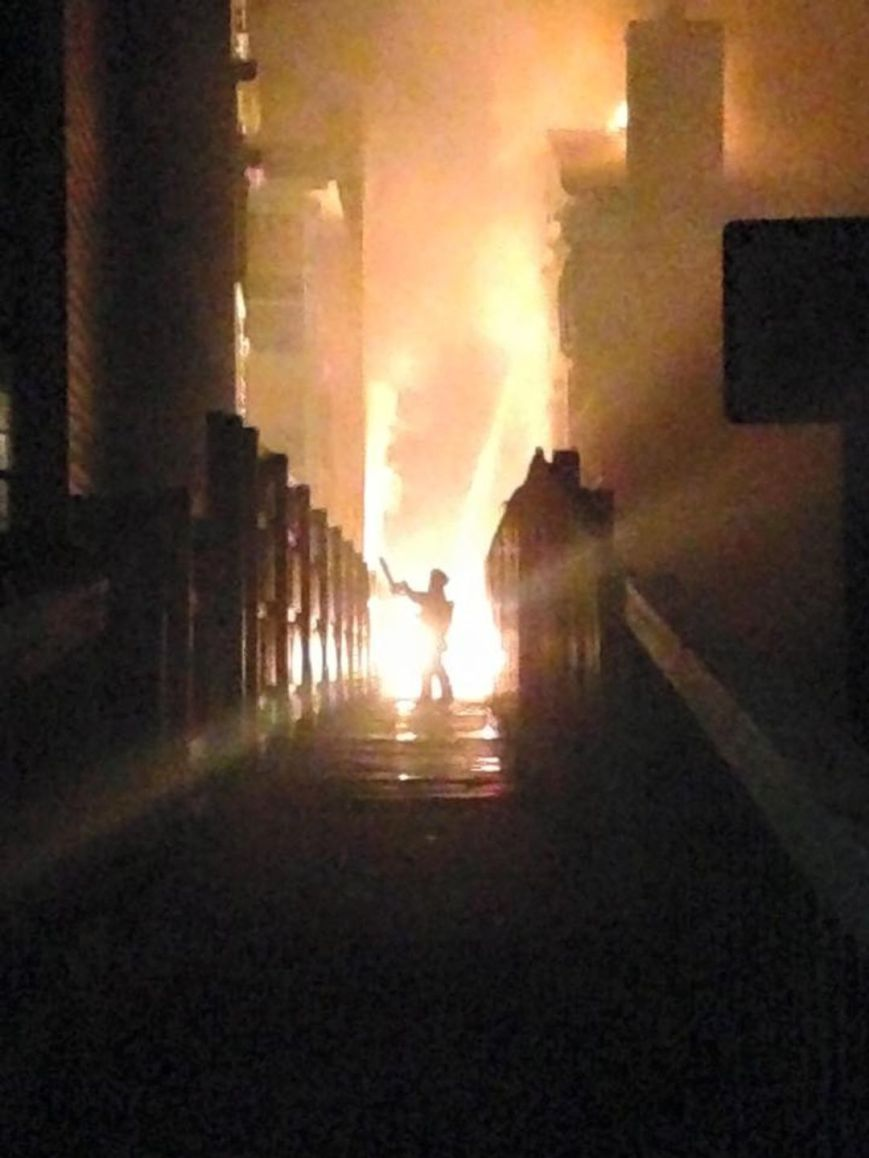 Fireman trying to fight the flames at the Page Court condo fire on April 23, 2015. (Photo: Bobbi Sawyers?,13News Now viewer