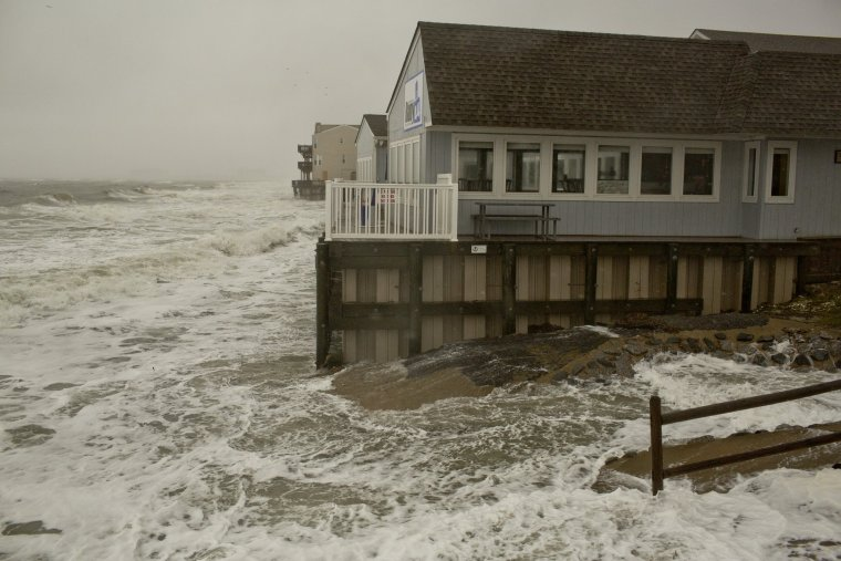 Breezy conditions and heavy rain affect the shoreline at Chic's Beach on Friday, Oct. 2, 2015, in Virginia Beach. (Rich-Joseph Facun | The Virginian-Pilot)