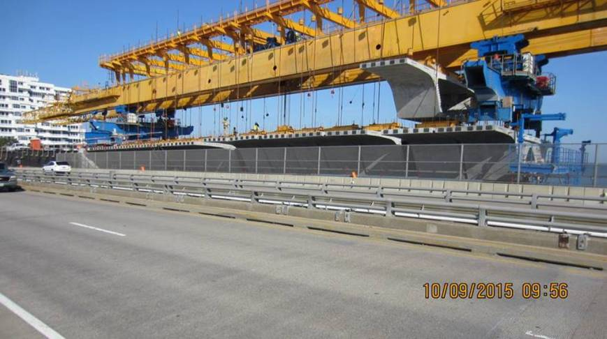Bridge Segments Attached to Erection Gantry with Hanging Bars (Westbound Bridge)  Epoxy Applied to Segment Faces Just Prior to Post-Tensioning (Westbound Bridge)
