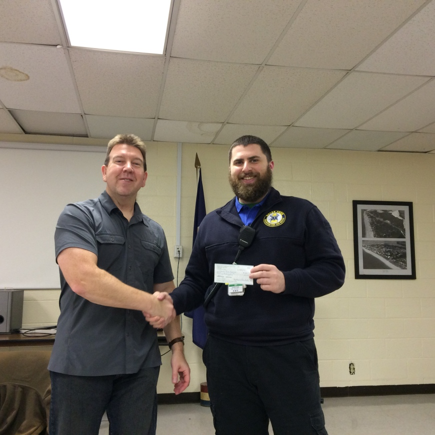 Todd presenting Brant with our $250 donation