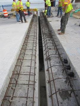 Area between abutment and bridge deck being prepared for expansion joint installation